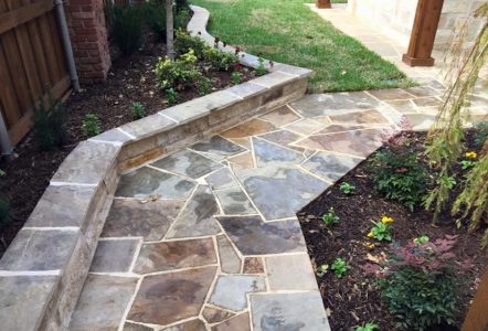 flagstone walkway with small wall