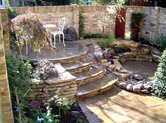 ornate romantic patio with flowers and flagstone
