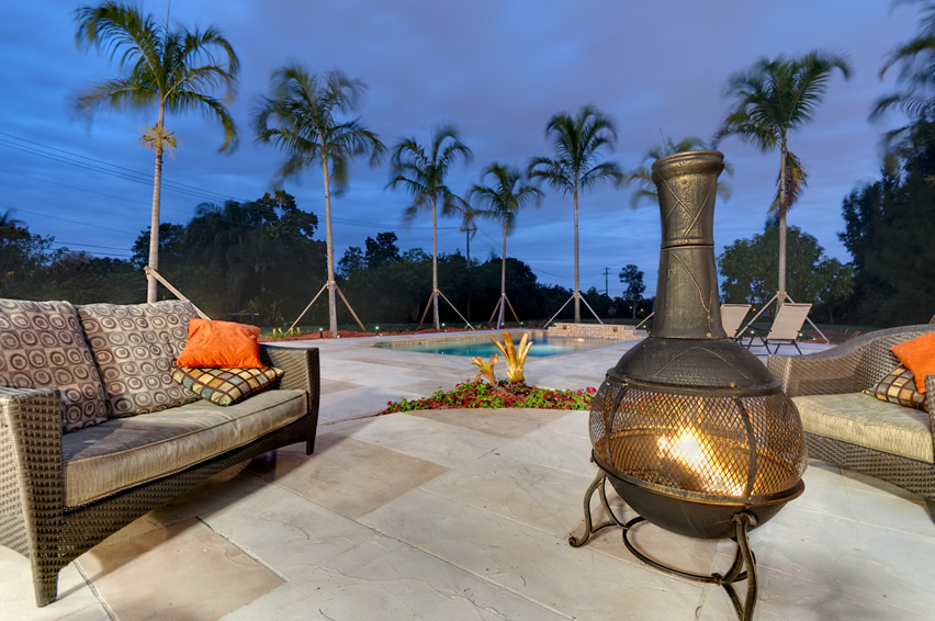 backyard-chiminea-fire-pit-by-pool