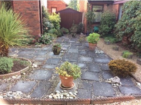 vijaya-gold-natural-slate-patio-with-raised-sleeper-flower-beds
